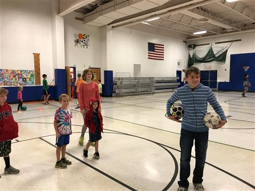 AWOD students working with Ms Richardson's class on soccer skills