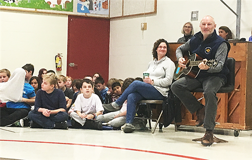 Scott Evans sings with third-graders