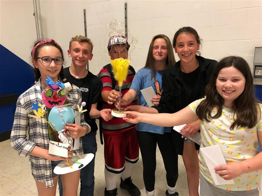 Students with the Feather Duster trophy and the winning creation.