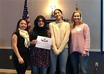 Fatima Kahn wins Essex Rotary Contest. Standing with three others holding award.