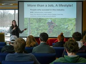 Amy McClure from the Killington School of Resort Management presenting to students on 12/05.