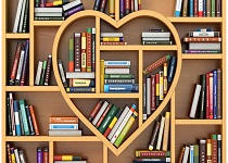 Library books on a heart shaped book shelf.
