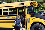 Kids getting on a school bus