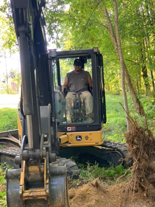 Tyler working heavy equipment
