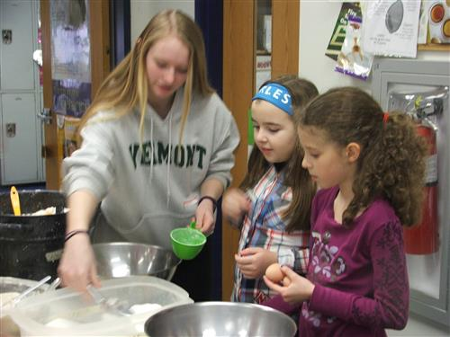 8th Graders Cooking with 4th Graders for Gather, Taste, Learn