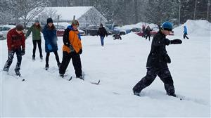 students xc skiing w/out poles