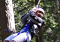 EHS student swinging at the UVM ropes course