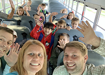 Summit students on a bus arriving at school