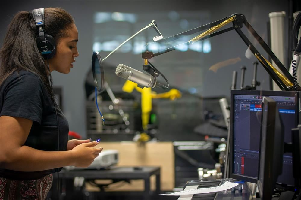 Image of Student recording in A/V studio